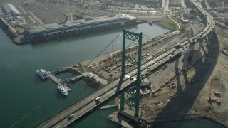 AX68_150 - 5K stock footage aerial video of light traffic crossing Vincent Thomas Bridge at the Port of Los Angeles in California