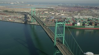 AX68_151 - 5K stock footage aerial video of cars and trucks crossing the Vincent Thomas Bridge at the Port of Los Angeles, California