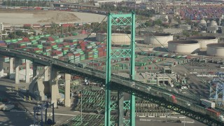 AX68_153 - 5K stock footage aerial video of Vincent Thomas Bridge and light traffic at the Port of Los Angeles, California