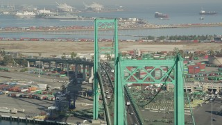 AX68_155 - 5K stock footage aerial video flyby Vincent Thomas Bridge with light traffic at the Port of Los Angeles, California