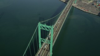 AX68_157 - 5K stock footage aerial video of a bird's eye view of light traffic on the Vincent Thomas Bridge, California