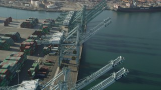 AX68_165 - 5K stock footage aerial video fly over cargo cranes at the Port of Los Angeles, California