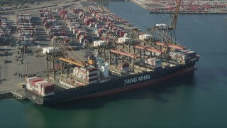 AX68_167 - 5K stock footage aerial video approach and flyby a cargo ship being unloaded at the Port of Los Angeles, California