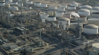AX68_174 - 5K stock footage aerial video of large tanks at Los Angeles Refinery Wilmington Plant in San Pedro, California