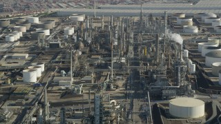 AX68_175 - 5K stock footage aerial video of Los Angeles Refinery Wilmington Plant structures in San Pedro, California