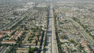 AX68_176 - 5K stock footage aerial video fly over light traffic on I-110 through suburbs in Carson, California