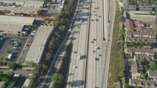 AX68_177 - 5K stock footage aerial video of bird's eye view of light traffic on I-110 in Carson, California