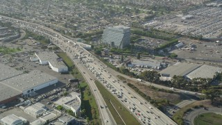 AX68_183 - 5K stock footage aerial video of heavy traffic on Interstate 405 through Torrance, California