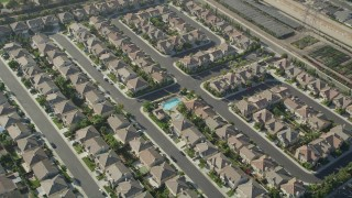 AX68_185 - 5K stock footage aerial video tilt to a bird's eye view of tract homes in Gardena, California