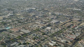 AX68_186 - 5K stock footage aerial video fly over apartment buildings and suburban homes in Gardena, California