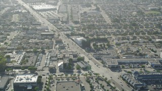 AX68_187 - 5K stock footage aerial video of Redondo Beach Boulevard with homes and strip malls in Gardena, California