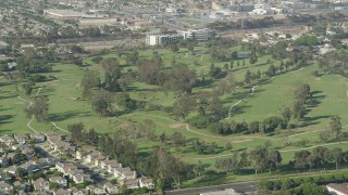 AX68_190 - 5K stock footage aerial video of golfers and carts at Chester Washington Golf Course in Hawthorne, California