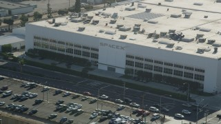 AX68_192 - 5K stock footage aerial video front of SpaceX office building in Hawthorne, California
