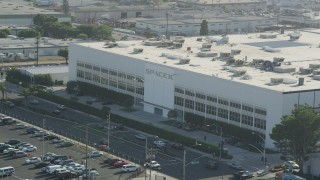 AX68_193 - 5K stock footage aerial video of the SpaceX office building and Crenshaw Boulevard in Hawthorne, California