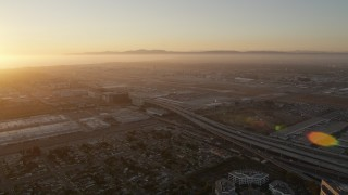 AX69_002 - 5K stock footage aerial video of sunset at Los Angeles International Airport in California