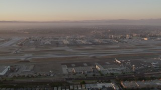 AX69_009 - 5K stock footage aerial video of a view of runways, terminals and hangars at LAX at twilight, Los Angeles, California