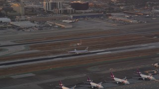 AX69_011 - 5K stock footage aerial video track American Airlines passenger jet landing at LAX at sunset, Los Angeles, California