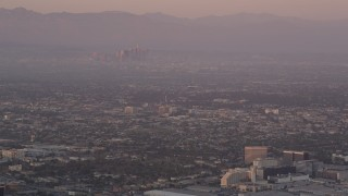 AX69_015 - 5K stock footage aerial video track airliner on approach to LAX at sunset, Los Angeles, California