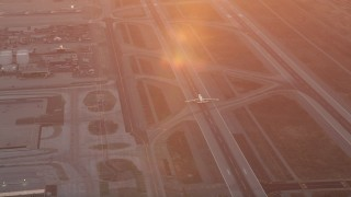AX69_016 - 5K stock footage aerial video track an airliner at sunset as it lands at LAX, Los Angeles, California