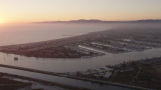 AX69_020 - 5K stock footage aerial video approach coastal community of Marina Del Rey at sunset, California