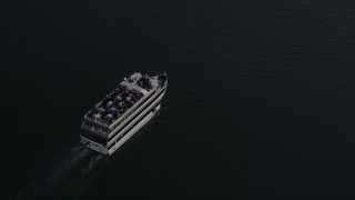 AX69_022 - 5K stock footage aerial video of tracking a ferry on the water in Marina Del Rey at sunset, California