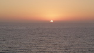 AX69_026 - 5K stock footage video of Pacific Ocean with the setting sun in the distance