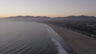 AX69_037 - 5K stock footage aerial video approach Santa Monica State Beach, deserted at twilight, California