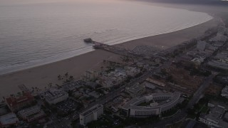 AX69_040 - 5K stock footage aerial video approach Santa Monica Pier and the beach at twilight, California