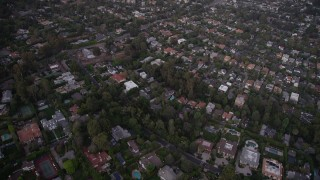 AX69_051 - 5K stock footage aerial video of flying over mansions and upscale houses at twilight in Brentwood, California