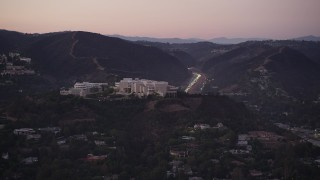 AX69_052 - 5K stock footage aerial video of J. Paul Getty Museum in the hills above Brentwood at twilight, California