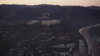 AX69_053 - 5K stock footage aerial video of J. Paul Getty Museum at twilight, Brentwood, California