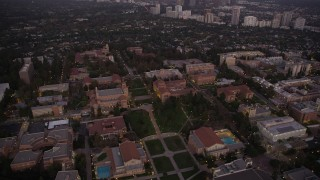 AX69_058 - 5K stock footage aerial video fly over Wilson Plaza, Dickson Court, and College campus buildings at twilight, Westwood, California
