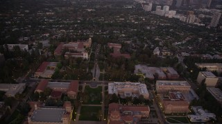 AX69_059 - 5K stock footage aerial video of flying over Dickson Court and buildings at the College campus at twilight, Westwood, California