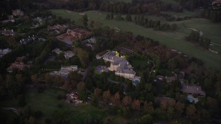 AX69_061 - 5K stock footage aerial video of spacious Holmby Hills mansion at twilight in Los Angeles, California