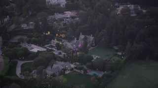 AX69_062 - 5K stock footage aerial video of orbiting the Playboy Mansion in Los Angeles, California, twilight