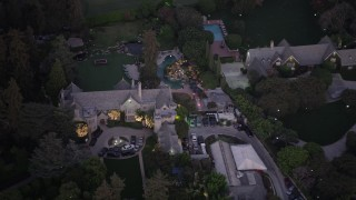 AX69_065 - 5K stock footage aerial video of circling The Playboy Mansion and grounds at twilight, Los Angeles, California