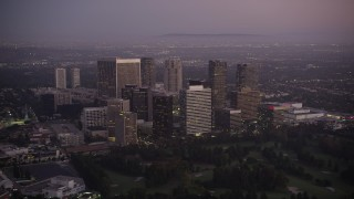 AX69_066 - 5K stock footage aerial video flyby skyscrapers in Century City at twilight, California