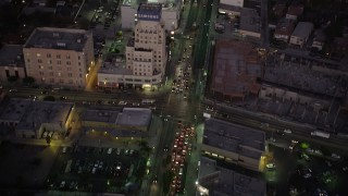 AX69_073 - 5K stock footage aerial video fly over office buildings on Wilshire Boulevard through Mid-Wilshire area of Los Angeles, California at twilight