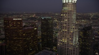AX69_083 - 5K stock footage aerial video fly over Two California Plaza in Downtown Los Angeles to reveal office buildings at night, California