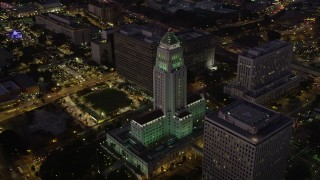 AX69_084 - 5K stock footage aerial video orbit Los Angeles City Hall in Downtown Los Angeles, California at night