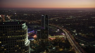 AX69_091 - 5K stock footage aerial video flyby 777 Tower to reveal The Ritz-Carlton and Staples Center in Downtown Los Angeles at twilight, California