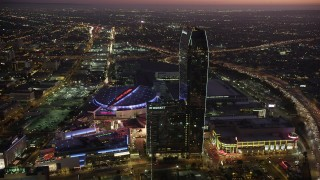 AX69_092 - 5K stock footage aerial video of Staples Center, JW Marriott, and The Ritz-Carlton in Downtown Los Angeles, California at twilight