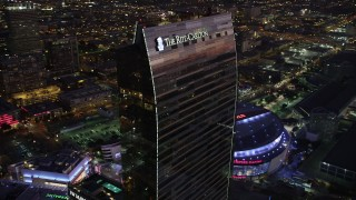 AX69_093 - 5K stock footage aerial video of the top of the Ritz-Carlton Hotel in Downtown Los Angeles, California at twilight