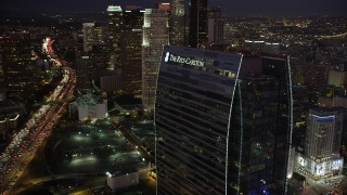 AX69_094 - 5K stock footage aerial video flyby the Ritz-Carlton Hotel to reveal skyscrapers in Downtown Los Angeles at night
