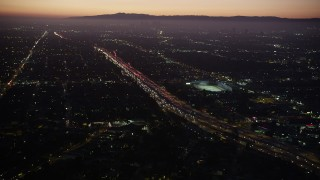AX69_096 - 5K stock footage aerial video of heavy traffic on I-10 past Pico-Union area of Los Angeles, California at twilight