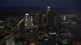 AX69_098 - 5K stock footage aerial video tilt to reveal Staples Center, Nokia Theater, hotels, and skyscrapers in Downtown Los Angeles, California at night