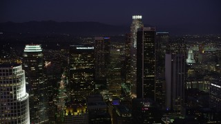 AX69_099 - 5K stock footage aerial video approach the tall skyscrapers of Downtown Los Angeles, California at night