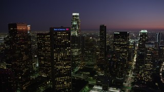 AX69_102 - 5K stock footage aerial video of Downtown Los Angeles skyscrapers at nighttime, California