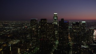 AX69_104 - 5K stock footage aerial video orbit tall high-rises in Downtown Los Angeles, California at night