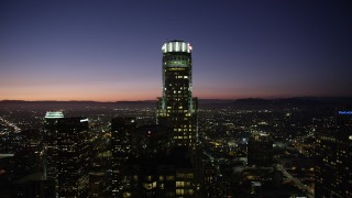 AX69_112 - 5K stock footage aerial video orbit of US Bank Tower in Downtown Los Angeles at night, California
